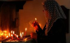 A Syrian Christian woman lights candles during a Good Friday mass at the Syriac church of the Holy Virgin in the northeastern city of Qamishli, on April during Easter celebrations Good Friday Mass, Syrian Christians, Easter Celebration, April 14, Christian Women, Votive Candles, Middle East, Christianity, Catholic