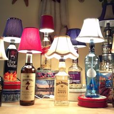 DIY Bottle Lamp. This would make such a cool gift for anyone who has a home bar, especially if you use a bottle of the recipient's favorite liquor or wine or a unique, or especially decorative bottle.