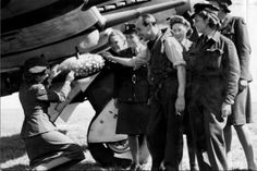 Wartime humour = putting post stamps on a bomb…  This photo was taken with the 609 typhoon squadron in Manston. The black and white stripes on the underside were no invasion stripes but recognition stripes to avoid friendly fire. When the hawker typhoon was introduced, the anti-aircraft batteries sometimes identified them as focke wulfs.