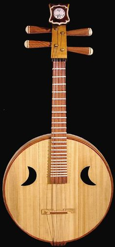 Traditional Chinese Plucked Stringed Musical Instrument Guitar Ruan http://www.interactchina.com/musical-instruments/
