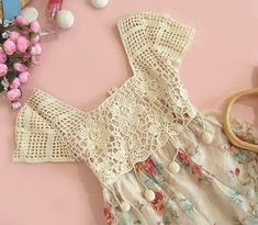 Sweet dress with crocheted top.  I think I would leave off the dangling balls thingies though!