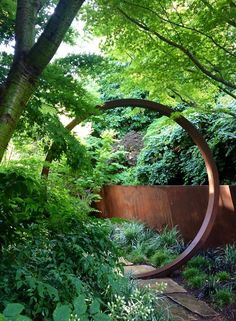 A moon gate and canted retaining wall are fashioned from Cor-Ten in this garden by Davis Dalbok of Living Green and Tim O'Shea of Greenworks Gardens. Cor-Ten, a variant of steel, is becoming increasingly popular in residential landscape design. Modern Landscape Design, Modern Landscaping, Contemporary Landscape, Landscape Architecture, Backyard Landscaping, Landscaping Software, Landscaping Design, Bamboo Landscape, Residential Landscaping