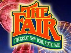 Syracuse, NY  NY State Fair.  Oh how I miss working/going there every summer!  Elephant ears, the Midway, Center of Progress Building....