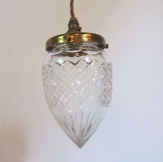 English pendant light in the original brass finish complemented by period cut glass shade. c 1900  www.antiquelightingcompany.com