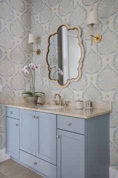 """""""The wallpaper was the inspiration for all of the design elements in this space, from the custom paint color on the vanity to the bone inlay mirror,"""" says interior designer Lauren Leonard."""