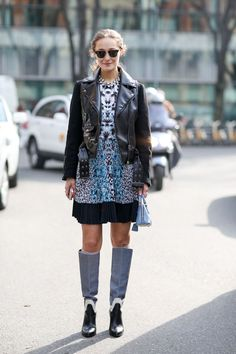 90+ Outfits That Are All About The Shape #refinery29  http://www.refinery29.com/2015/03/83106/milan-street-style-mfw-2015#slide-72  Cropped jacket and tall boots makes for a cool look when just a little skin is left uncovered. Sounds like an old proverb, no?