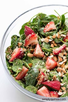 Strawberry Spinach Salad with Toasted Quinoa + Chopped Almonds | www.simplyquinoa.com | This makes for the perfect summertime meal - fresh, flavorful and delicious