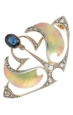 An Art Nouveau Diamond Enamel Brooch. Of Scottish and Celtic influence, the overall configuration implies a rendering of a butterfly. Silver-topped 18k yellow gold openwork mount set with twenty-six rose-cut diamonds, an oval faceted sapphire and applied with translucent polychromatic enamel to 'wings'.