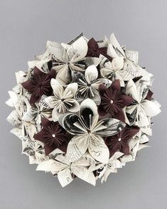 Bouquet made from paper flowers. Could maybe make the flowers from favourite books, sheet music etc.