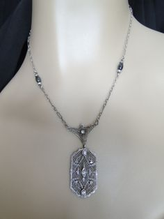Antique Art Deco Sterling SIlver Filigree Faux Diamond Marcasites Necklace Pendant. $110.00, via Etsy.
