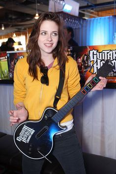 Kristen Stewart Turns 23 — See Her Grow From Child Star to Sexy Starlet!: Kristen Stewart played Guitar Hero at a Fred Segal event in Park City, UT, in January 2008 during the Sundance Film Festival.