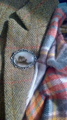 Very proper. Some tweed, some plaid, and an oval brooch.