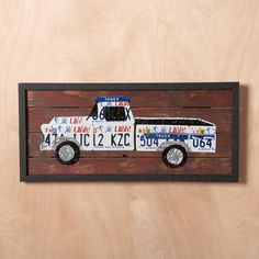 LICENSE PLATE WALL ART, ALL 50 STATES--Modern folk art for all 50 states. A fitting tribute to America's legendary fascination with the open road and our equally intense passion for the states near and dear to us. Each and every one of them is available, individually crafted by artist Aaron Foster from hand-cut vintage license plates, waxed, sanded and assembled by hand. A lighthearted and heartfelt reminder of your roots, your favorite vacation spot or your adopted home. Cedar backing. Red...