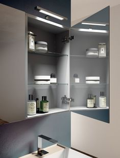 Mirror cabinet with LED light and double sided mirror doors. Made by LASA Idea, Italy.