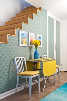 this looks crazy dangerous (no railings or banister?), but i love the wallpaper and yellow table and chairs.
