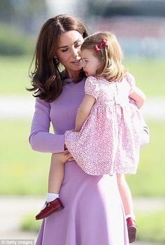 Charlotte is comforted by her mother after taking a tumble...