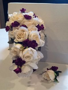 Silk bouquet and boutonnière using cream or white roses and and accent color. Choose round or cascade style.