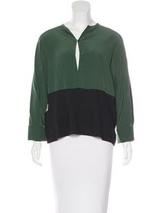 Emerald and black Marni colorblock blouse with long sleeves, tonal stitching throughout and keyhole featuring single button closure at front.