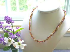 Braided Gold, Silver, and Mauve Necklace