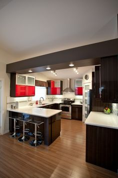 My Dad would love this kitchen...he has this thing for red and black.