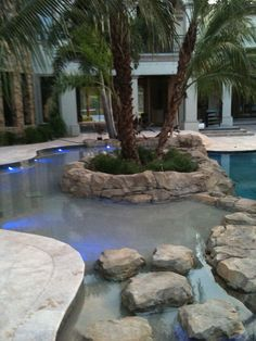 I like the lighting on the side very nice Pool design..the boulders in the water are a nice touch