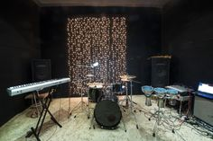 Studio room setup with musical instruments and record equipment