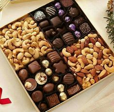 The ultimate hostess gift! A wonderful selection of our delicious assorted chocolates and freshly roasted nuts. Fruit Buffet, Dessert Platter, Party Food Platters, Chocolate Lasagna, Chocolate Packaging, Chocolate Treats, Snacks, Food Presentation, Yummy Cakes