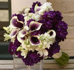 Hydrangea, calla lilies and freesia in purples and whites