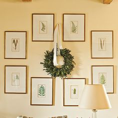 Rearrange your prints like these botanicals for the season to make room for a wreath. Simply tie it with a knot of satin ribbon.