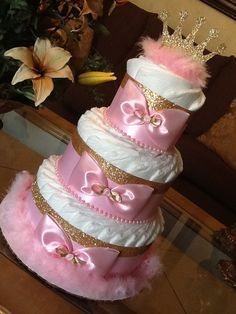 Princess diaper cake/Pink and gold diaper by InspiredbyElena . Princess diaper cake/Pink and gold diaper by InspiredbyElenaPink and Gold Diaper Cake Baby Shower Idee Baby Shower, Baby Shower Crafts, Shower Bebe, Baby Shower Diapers, Girl Shower, Baby Shower Parties, Baby Shower Themes, Shower Ideas, Shower Gifts