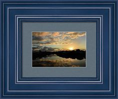 Sun Rays At Sunrise Color The Clouds And Reflections Framed Print featuring the photograph Sun Rays At Sunrise Color The Clouds And Reflections by Debra Martz