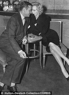 Marilyn and Laurence at a press conference at the Savoy Hotel, 1956