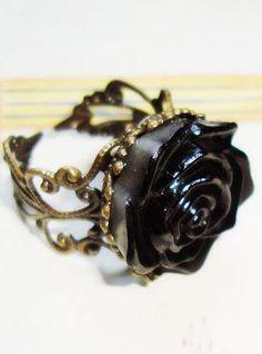 http://www.sheinside.com/Black-Rose-Retro-Gold-Ring-p-110770-cat-1759.html