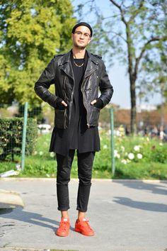 Repin: Wearing red trainers with black skinny jeans, longline t-shirt, black cardigan and a black leather biker jacket