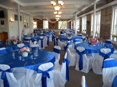 royal blue wedding Small Pink & white centerpieces on Royal Blue--don't like this--very plain