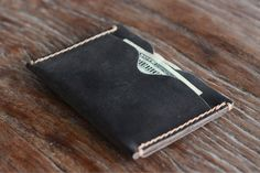 Our newest creation is a hybrid in every sense. It has the full functionality of a bifold wallet but comes in the shape and size of sleeve.    One side