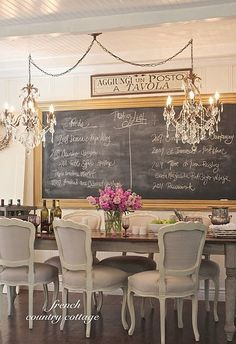 love the chandeliers, the chalkboard, and the lines of the chairs.