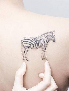 Illustrative zebra tattoo on the right shoulder blade. Tattoo artist: Mini Lau