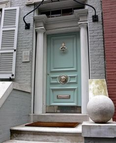 blue door color, large silver knocker - Is it Miles Redd's house? I looks to be from a recent House Beautiful article on front door colors. Aqua Door, Turquoise Door, Mint Door, Light Turquoise, Front Door Design, Front Door Colors, Le Grand Bleu, Doors Galore, Azul Tiffany