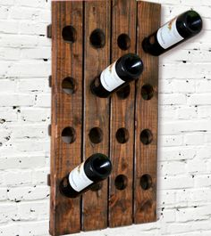 Could DIY with pallets. Wine Rack Riddling Rack Wood Wall Hanging  (Walnut). $49.99, via Etsy.
