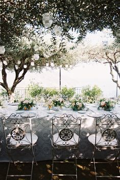 If youre wanting a destination wedding with breathtaking views and sunny days then the Amalfi Coast in Italy is a must! This gorgeous wedding in Ravello has cute pops of citrus at their family style reception under olive trees.