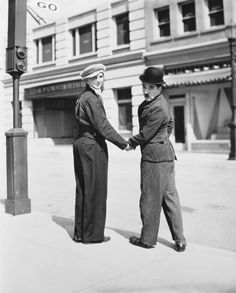 """Jackie Coogan visiting Chaplin on the set of """"City Lights"""" (1931) ten years after """"The Kid"""" where Jackie was 7"""