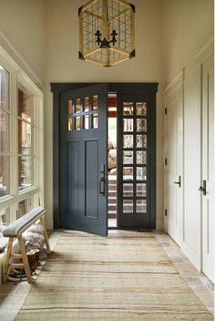 My favorite idea for a new hall to front of house. Love the closets and the tall ski bench. Beautiful door too.