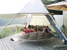 Sunbed Patio With Large Capacity And The Strong Hanging Bed For Three Capacity People Find Interactive Ideas for Hanging Outdoor Bed http://seekayem.com