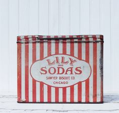 Vintage Tin Red and White Stripes Lily Soda.