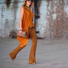 http://thezoereport.com/wp-content/uploads/2015/08/flared-trousers-silk-top-orange-street-style-orange-600x600.jpg