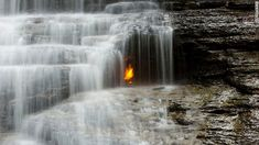 Behind the cascade of a small waterfall in the Shale Creek Preserve section ofChestnut Ridge Parkin suburban Buffalo, New York, you might see what appears to be an optical illusion: a flickering golden flame. Actually, you'll smell it before you see it, and amazingly, it's real, fueled by what geologists call a macroseep of natural gas from the Earth below.