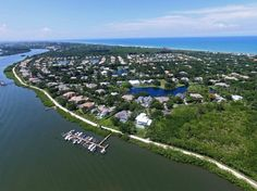 Ocean-to-river living. Custom home on .56 acre cul-de-sac. Inviting formal - informal rooms view 60ft+ lanai, pool/spa. Design features include fireplace, bookcases, millwork, hardwood, tile, 2 pane windows. Large kitchen open to family room extends to billiard room. Thermador cooktop. Master closet