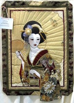 """Geisha With Parasol"" was made and quilted by Jody Webb. This quilt had it all. It is not easy to use embellishments on a quilt. So often they just look like someone added something because the quilt wasn't working. The embellishing Jody did was an integral part of the design and the quilt."