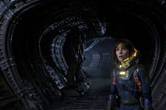 Noomi Rapace in Prometheus with a couple familiar looking creatures in the background